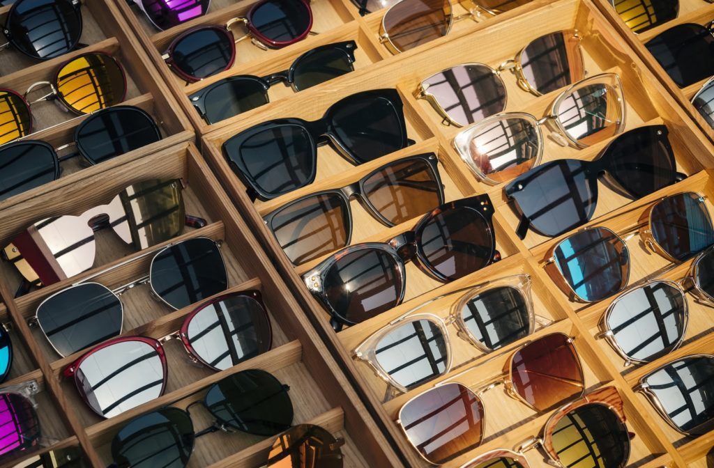 Sunglasses on display in wooden trays