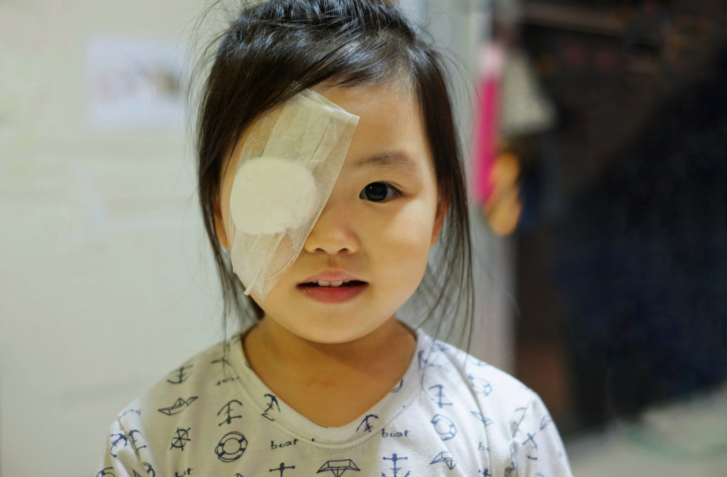 Young girls right eye covered with eye patch after an eye emergency.